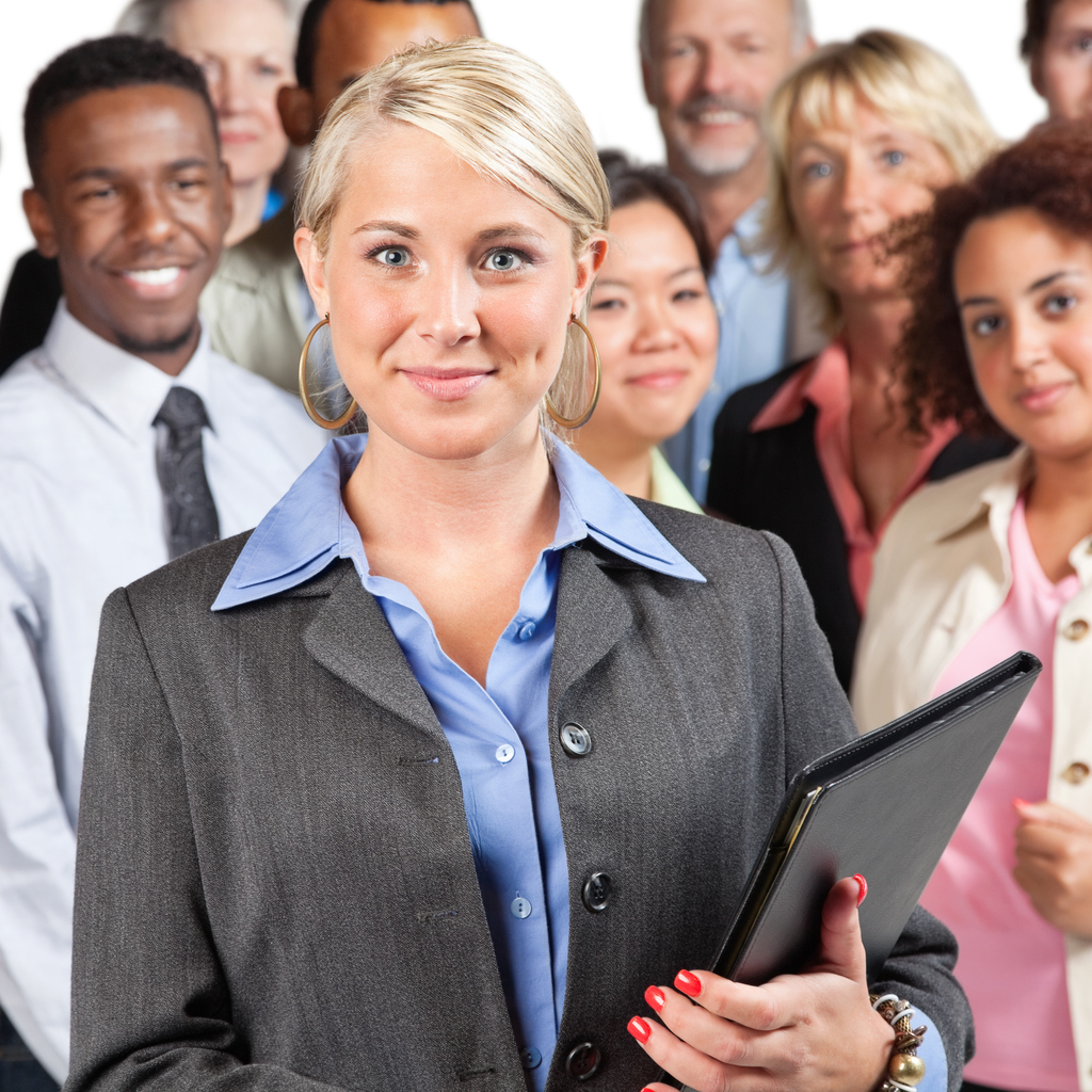 Young businesswoman in front of peer group.