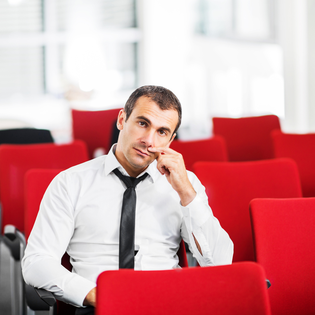 Businessman sitting alone on a seminar.